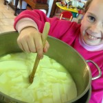 No 2 daughter stirring the curd