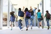 28198241-six-students-running-to-front-door-of-school-excited